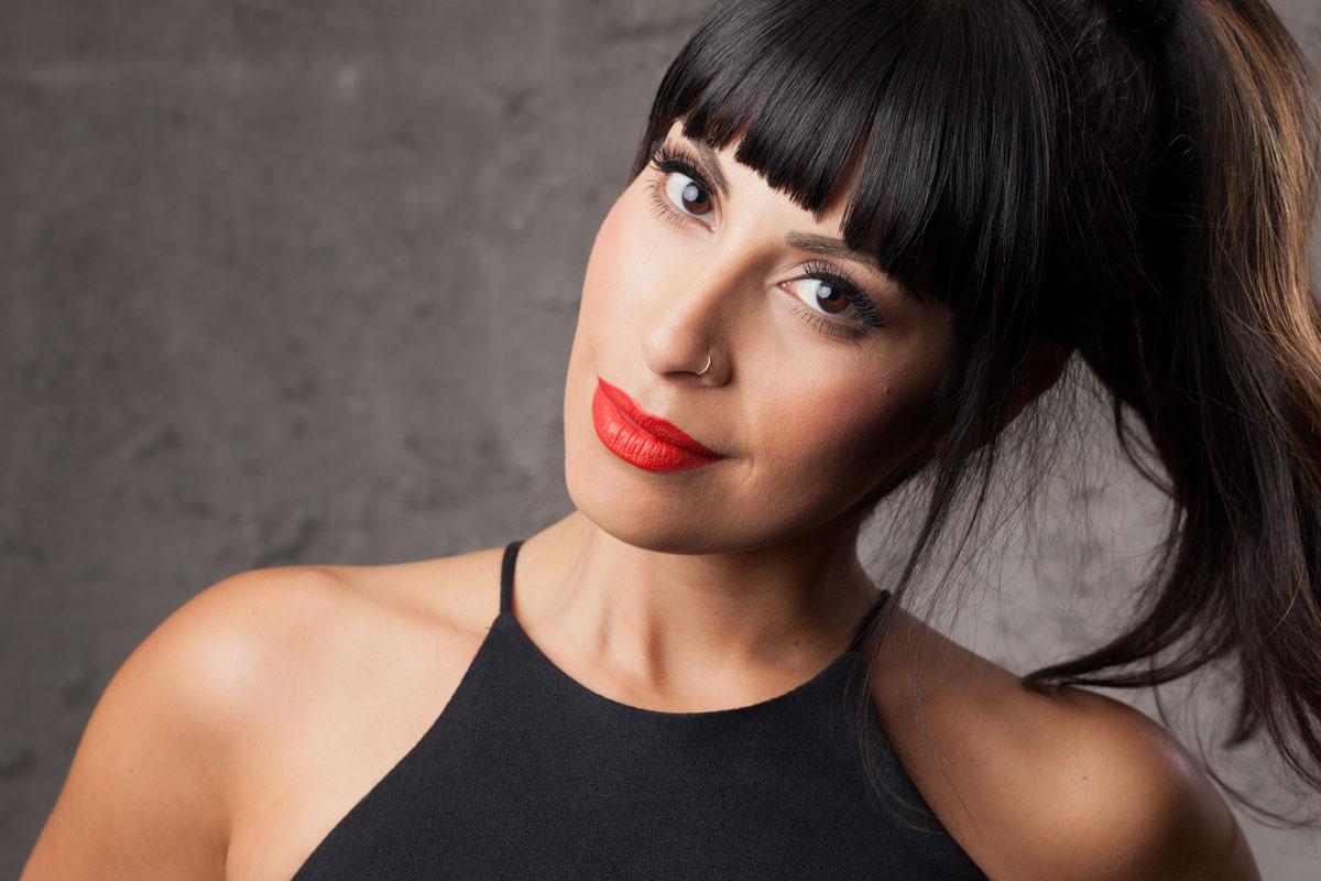 Andrea Ortega headshot on white background.
