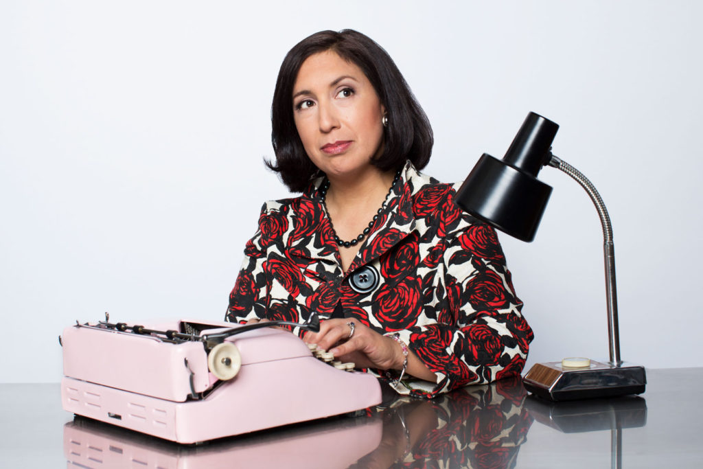 Portrait of Author at work at her typewriter