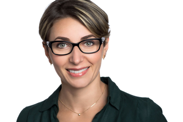 Headshot of smiling woman with glasses