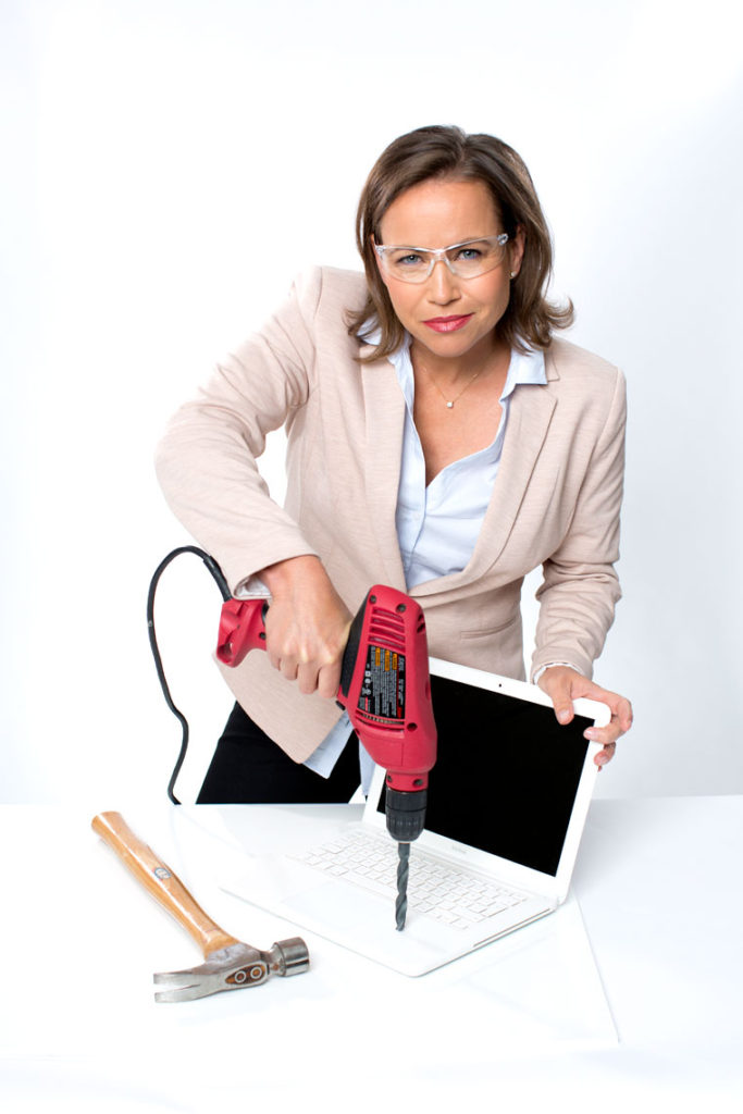 Woman with Drill and hammer