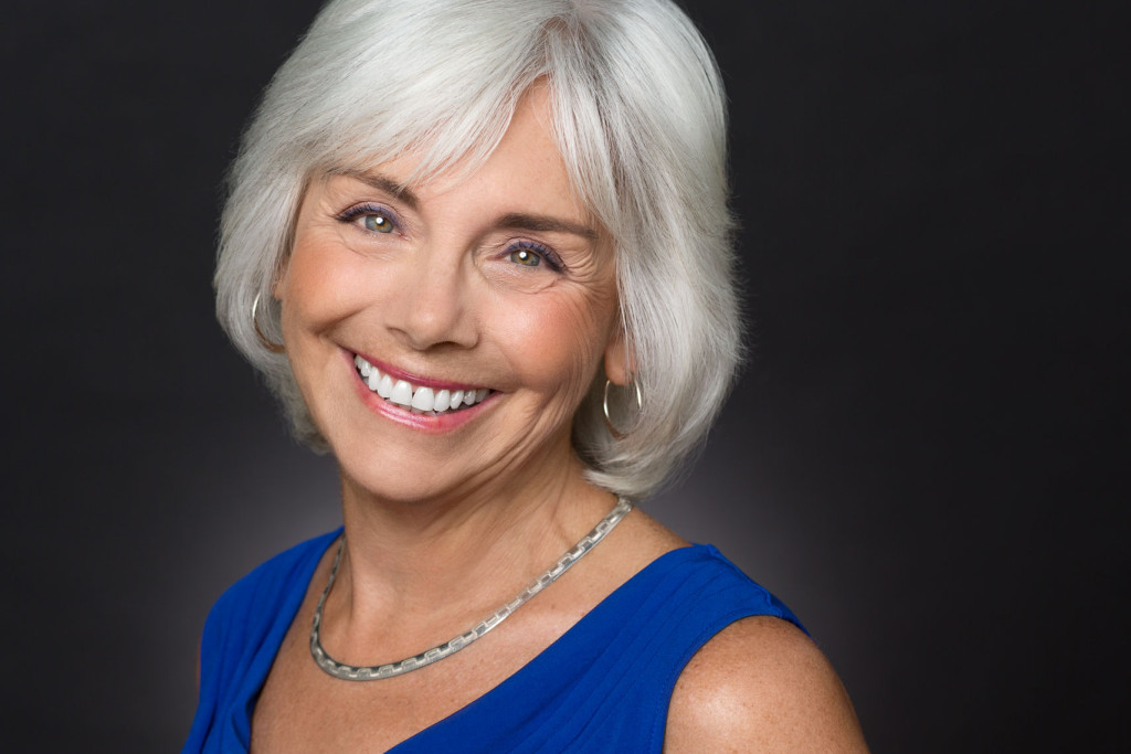 Headshot of Actress with grey hair and smile with color correction makeup