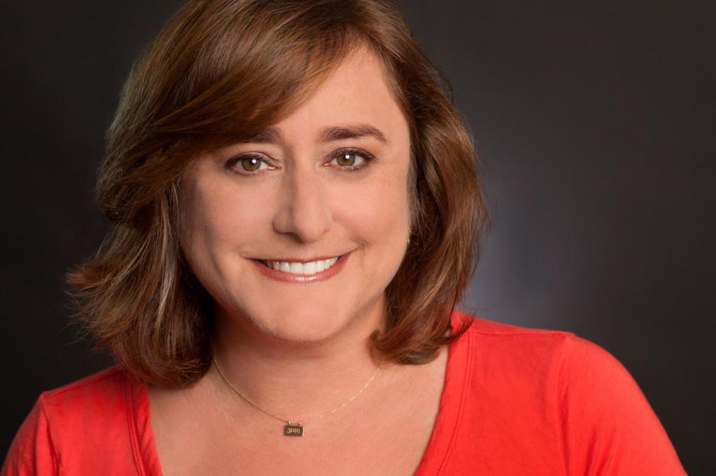 Headshot of Julie Feinstein Adams on Dark Background
