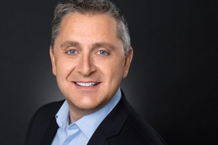 Headshot of Smiling Executive