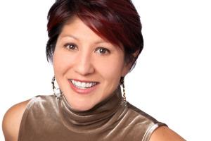 Headshot of Smiling woman on white background.