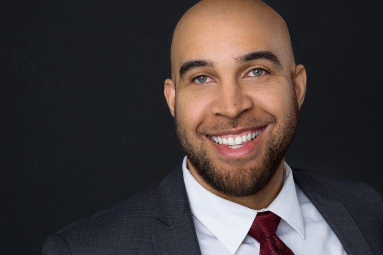 Headshot of bearded man smiling