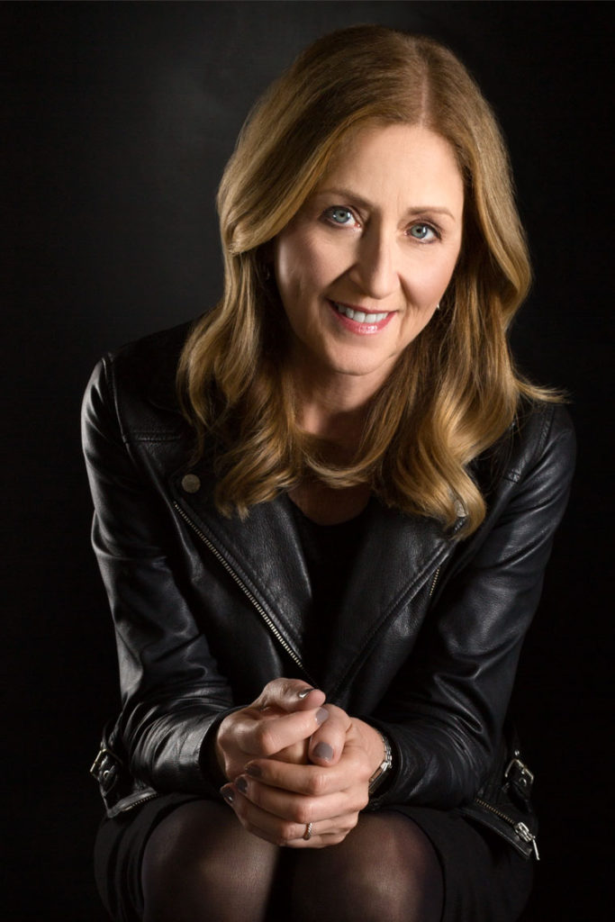 Portrait of Smiling woman with green eyes in Leather Jacket