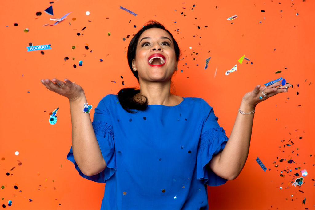 Woman throwing confetti in the air for personal branding.
