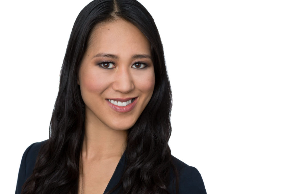 Headshot of smiling woman with color correction makeup