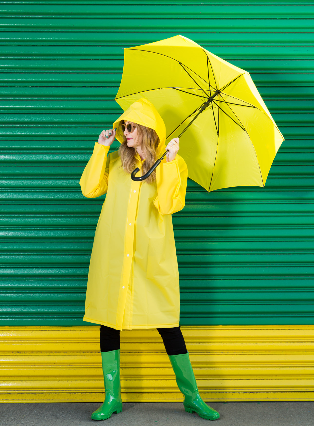 Portrait of woman in raincoat in front of truck door